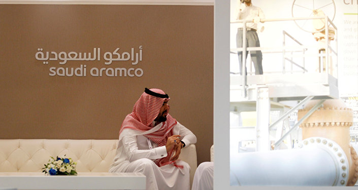A Saudi Aramco employee sits in the area of its stand at the Middle East Petrotech 2016, an exhibition and conference for the refining and petrochemical industries, in Manama, Bahrain, September 27, 2016.