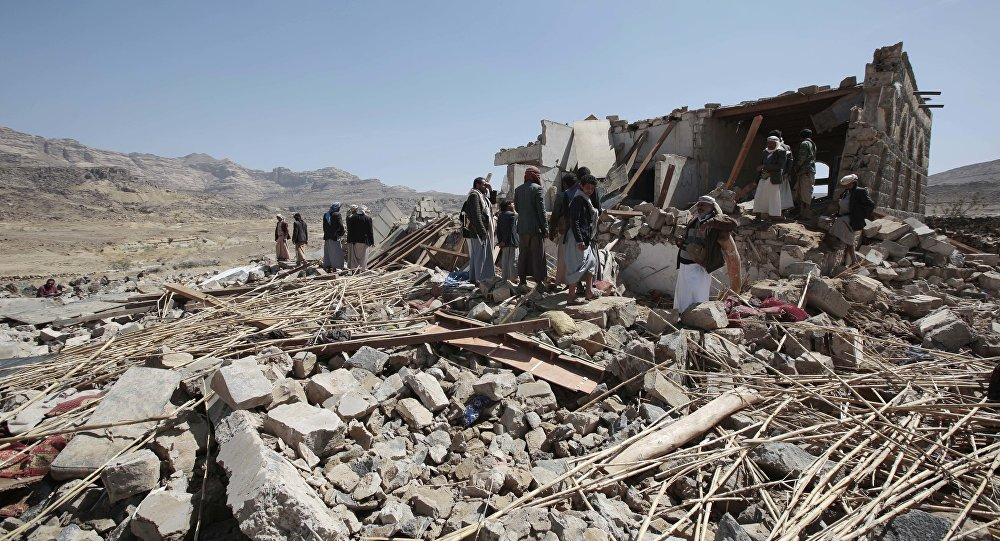 People inspect a house destroyed by a Saudi-led airstrike in the outskirts of Sanaa, Yemen, Thursday, Feb. 16, 2017