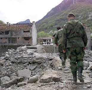 Yugoslav soldiers walk on Murino bridge alledgedly damaged by NATO air strikes, some 130 km from Podgorica, 02 May 1999