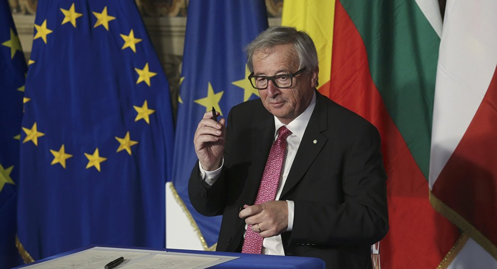European Commission President Jean-Claude Juncker holds up a pen after signing document during the EU leaders meeting on the 60th anniversary of the Treaty of Rome, in Rome, Italy March 25, 2017