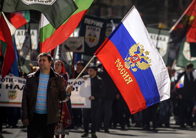 This picture taken on March 3, 2017, shows a man marching with a Russian flag during a political rally on Bulgaria's National Day in central Sofia