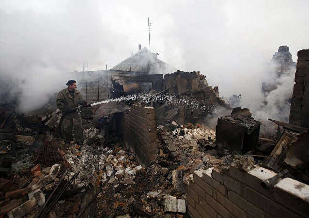 A firefighter douses a fire in Avdiivka after heavy shelling  (File)