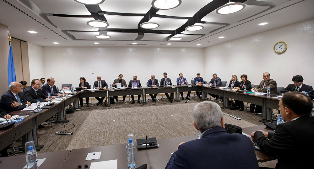 Deputy UN Special Envoy for Syria Ramzy Ezzeldin Ramzy and Syria's main opposition High Negotiations Committee (HNC) leader Nasr al-Hariri attend a round of negotiation during the Intra Syria talks at the European headquarters of the United Nations in Geneva, Switzerland, Monday, March 27, 2017