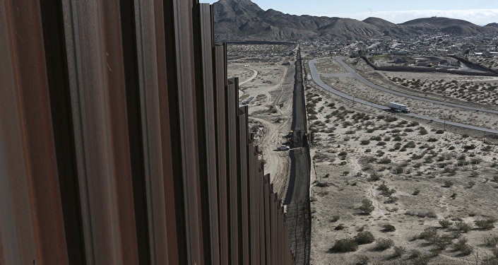 A truck drives near the Mexico-US border fence, on the Mexican side, separating the towns of Anapra, Mexico and Sunland Park, New Mexico