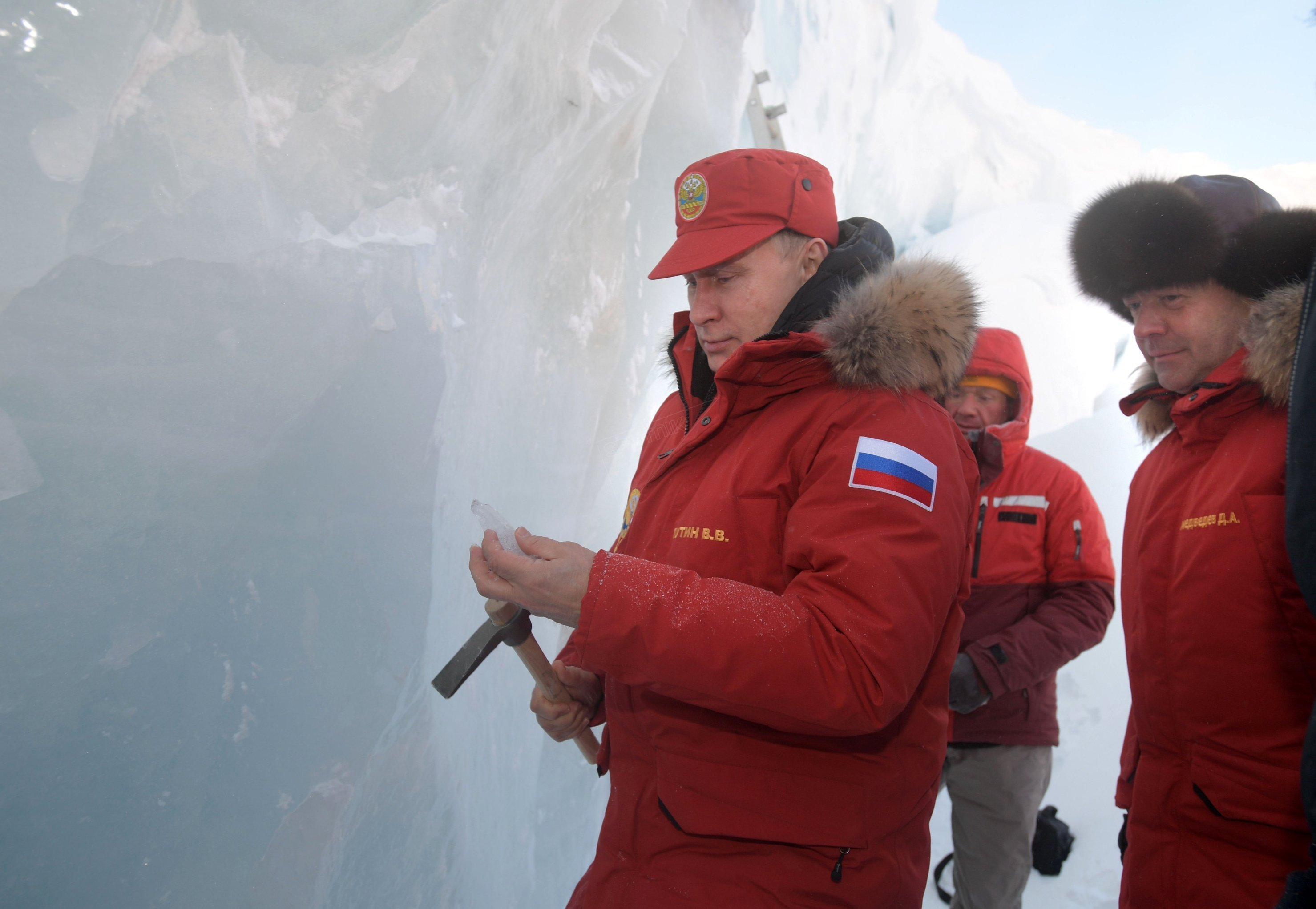 Russian President Vladimir Putin and Prime Minister Dmitry Medvedev visit the Polar Pilots Ice Cave on Alexandra Land Island in the Franz Josef Land Archipelago