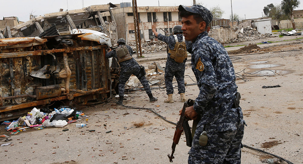 Federal police members take cover during a battle with Daesh fighters at Bab al Beed district in the old city of Mosul, Iraq, March 31, 2017