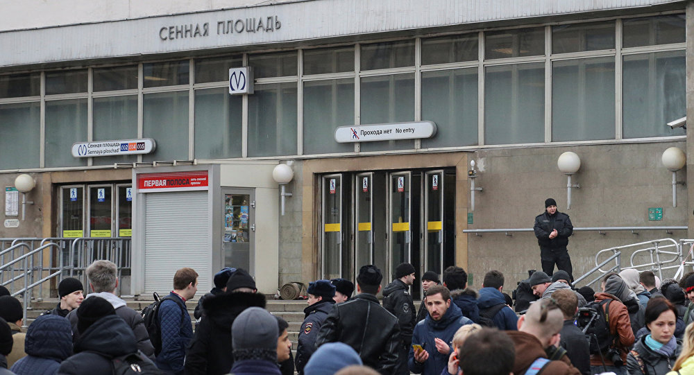 People gather outside Sennaya Ploshchad metro station after an explosion tore through a train carriage in the St. Petersburg metro system, in St. Petersburg, Russia April 3, 2017
