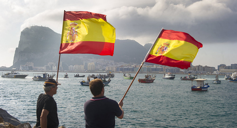 Spanish fishermen wave Spanish flags during a protest in the bay of Algeciras on August 18, 2013. A Spanish protest fleet of 38 fishing boats sailed towards Gibraltar today to demand the British outpost remove 70 concrete blocks it has dropped in their fishing grounds.