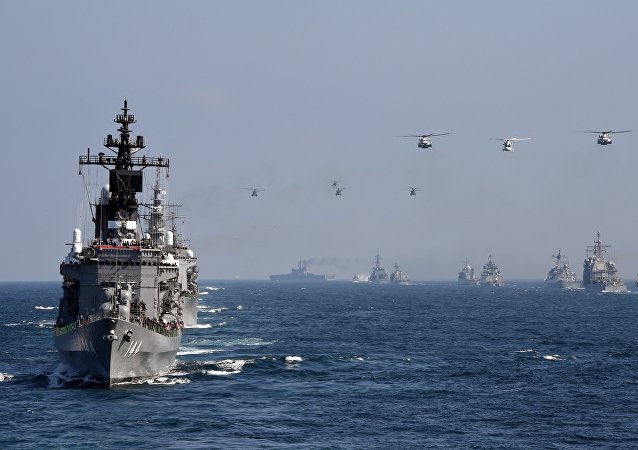 Japan's Maritime Self-Defense Force (MSDF) escort ship Kurama (L) takes part in a fleet review off Sagami Bay, Kanagawa prefecture.