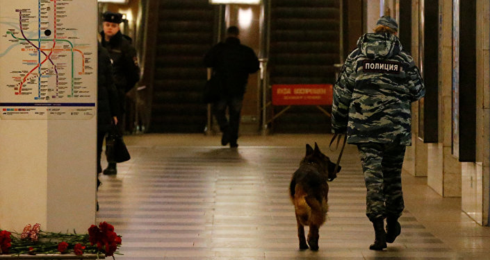 A police officer walks with a dog at Tekhnologicheskiy institut metro station in St. Petersburg, Russia, April 4, 2017
