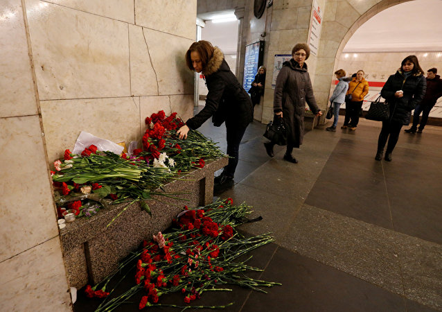 A woman lays flowers in memory of victims of a blast in St.Petersburg metro, at Tekhnologicheskiy institut metro station in St. Petersburg, Russia, April 4, 2017
