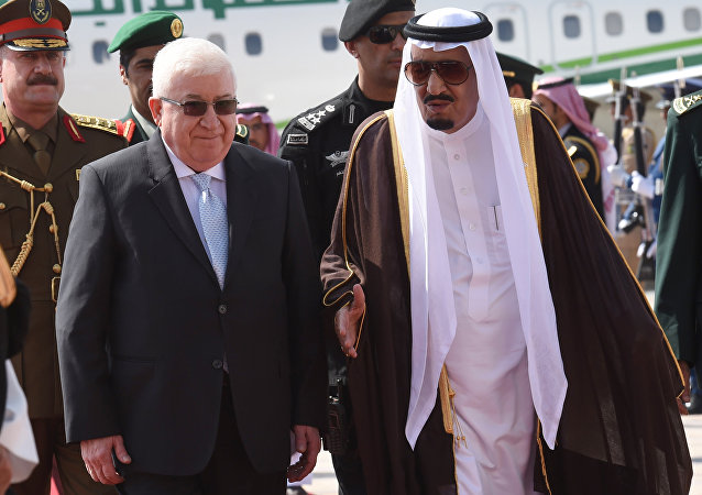 Saudi Arabia's King Salman (R) escorts Iraqi President Fuad Masum, during a welcoming ceremony at the King Khalid International airport in Riyadh, on November 10, 2015