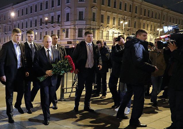Russian President Vladimir Putin is seen here outside Tekhnologichesky Institute metro station in St. Petersburg where he laid flowers in memory of the victims of the metro train blast