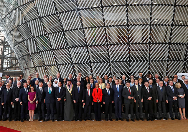 Foreign Ministers and officials pose for a group photo as they take part in an international conference on the future of Syria and the region, in Brussels, Belgium, April 5, 2017.