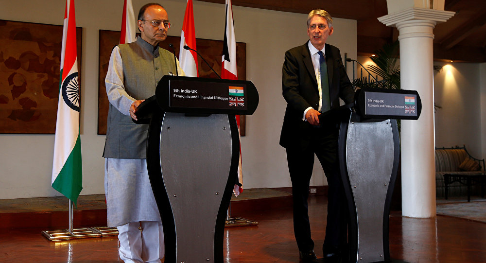 Britain's Chancellor of the Exchequer Philip Hammond (R) speaks during a joint news conference with India's Finance Minister Arun Jaitley in New Delhi, India April 4, 2017.