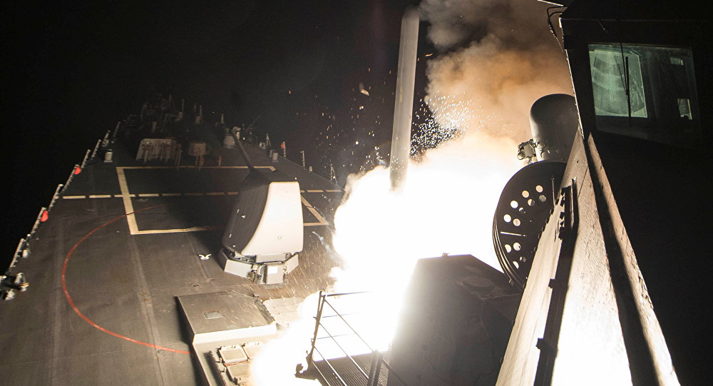 Navy guided-missile destroyer USS Ross (DDG 71) fires a tomahawk land attack missile in Mediterranean Sea which U.S. Defense Department said was a part of cruise missile strike against Syria on April 7, 2017.