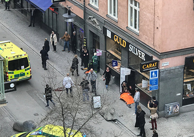 Ambulance in a street near the site were a truck was driven into a crowd in central Stockholm, Sweden