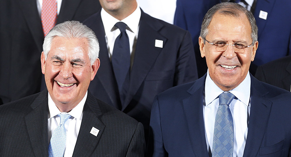 The Russian foreign minister Sergey Lavrov, right, and US Secretary of State Rex Tillerson stand together during the G-20 Foreign Ministers meeting in Bonn, Germany