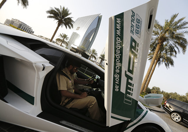 Emirati policemen patrol in an especially modified Lamborghini Aventador on April 16, 2013 in the Gulf emirate of Dubai