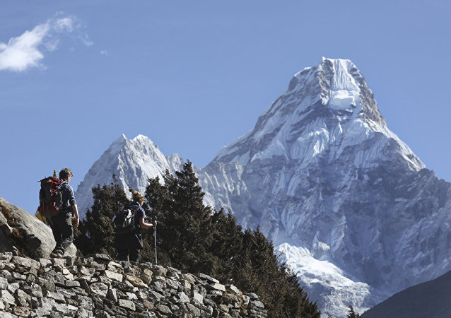 In this Feb. 19, 2016, file photo, trekkers make their way to Dingboche, a popular Mount Everest base camp, in Pangboche, Nepal.