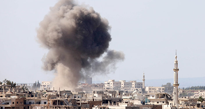 Smoke billows following reported air strikes on a rebel-held area in the southern Syrian city of Daraa, on April 4, 2017
