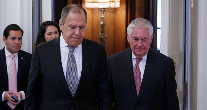 Russian Foreign Minister Sergei Lavrov and U.S. Secretary of State Rex Tillerson enter a hall during their meeting in Moscow, Russia, April 12, 2017