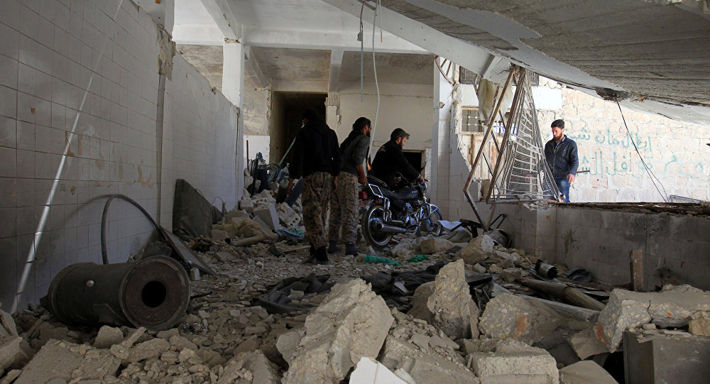 Men salvage a motorbike amid the damage inside a medical point at a site hit by airstrikes on Tuesday, in the town of Khan Sheikhoun in Idlib, Syria April 5, 2017
