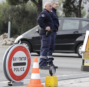 French custom officers keep watch on cars in La Turbie, southeastern France, near the Franco-Italian border, in spite of the EU's passport-free zone Schengen, as security measures are taken ahead of the G20 Summit of Cannes, Monday, Oct.31, 2011.