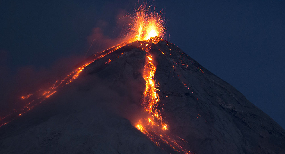 Volcan de Fuego, or Volcano of Fire, spews hot molten lava from its crater in San Juan Alotenango, Guatemala, Wednesday, July 1, 2015.