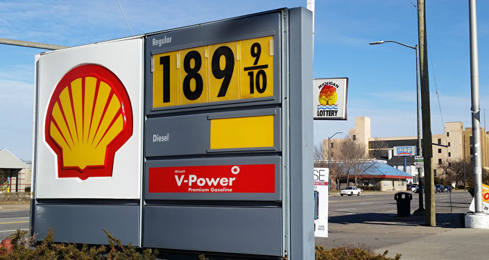 A sign shows the price of gasoline at a Shell station near downtown Detroit on Thursday, Jan. 1, 2015.