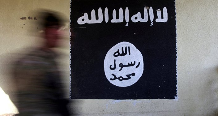 A member of the Iraqi rapid response forces walks past a wall painted with the black flag commonly used by Islamic State militants, at a hospital damaged by clashes during a battle between Iraqi forces and Islamic State militants in the Wahda district of eastern Mosul, Iraq, January 8, 2017.