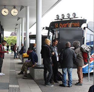 Migrants wait for a bus at the shared bus station of the northern Swedish town Haparanda and its Finnish twin town Tornio on the Swedish-Finnish border (Photo used for illustration purpose)