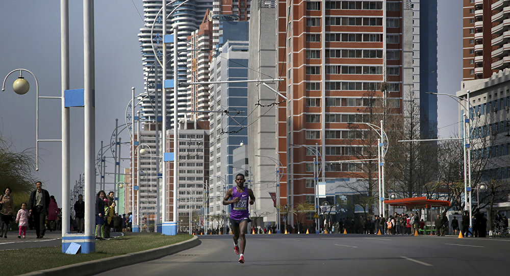 A participant of the Pyongyang marathon runs down Mirae Scientist Street on Sunday, April 9, 2017, in Pyongyang, North Korea.