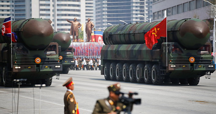 Missiles are driven past the stand with North Korean leader Kim Jong Un and other high ranking officials during a military parade marking the 105th birth anniversary of country's founding father Kim Il Sung, in Pyongyang April 15, 2017