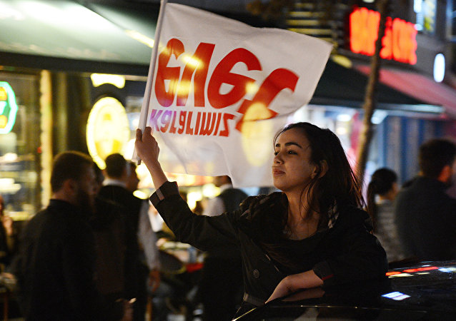 Supporters of Turkish President Tayyip Erdogan celebrate victory in the Turkey's constitutional referendum