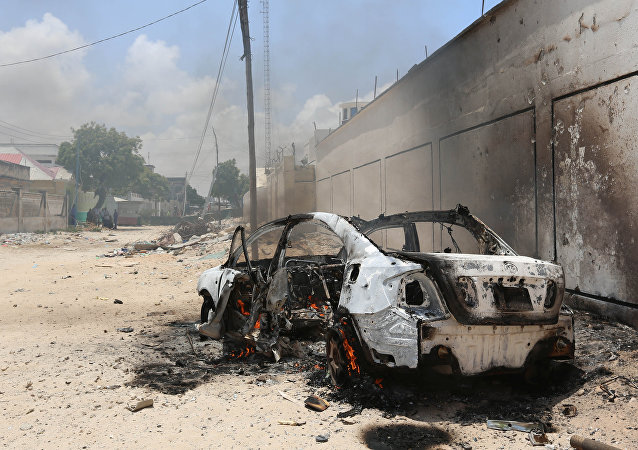 A burning car is seen after a clash among gunmen and security members, in Madina district of Somalia's capital Mogadishu, April 16, 2017