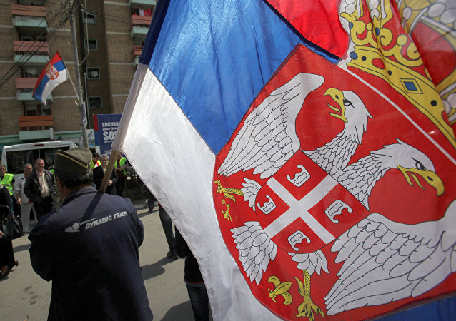 Kosovo Serb caring Serbian flag during the protest against recognition of Kosovo as an independent state, in the northern Serb-dominated part of the ethnically divided town of Mitrovica, Kosovo, Monday, April 22, 2013
