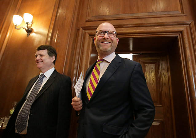 Leader of Britain's United Kingdom Independence Party (UKIP), Paul Nuttall (R) arives to deliver a Brexit speech in London on March 27, 2017