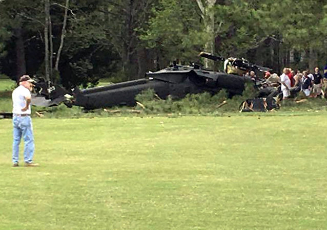 People examine an Army UH-60 helicopter from Fort Belvoir, Va., after it crashed at the Breton Bay Golf and Country Club after Monday, April 17, 2017, in Leonardtown, Md.