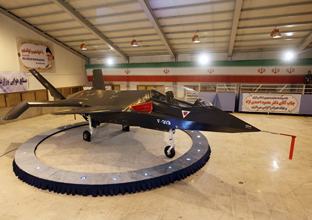 Iran's domestically designed and built Qaher (Conqueror) F-313 fighter jet is unveiled during a ceremony in a warehouse in Tehran on February 2, 2013