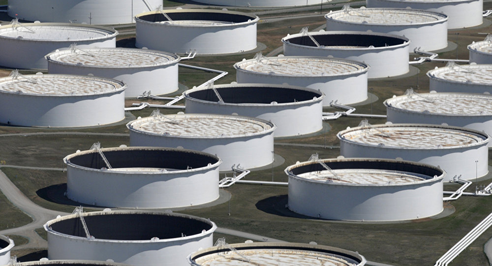 Crude oil storage tanks are seen from above at the Cushing oil hub, appearing to run out of space to contain a historic supply glut that hammered prices, in Cushing, Oklahoma, March 24, 2016