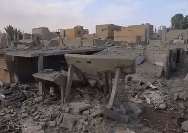 A still image taken from a video released on the internet by Islamic State-affiliated Amaq News Agency, on April 18, 2017, purports to show the aftermath, said to be in al-Bukamal town, in Deir al-Zor province, after air strikes thought to have been directed by planes from a U.S.-led military coalition, Syria