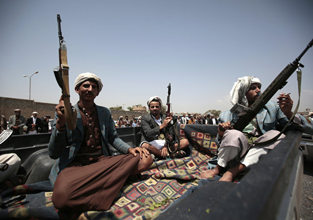 Tribesmen loyal to Houthi rebels ride on a patrol truck during a gathering aimed at mobilizing more fighters into battlefronts in several Yemeni cities, in Sanaa, Yemen, Thursday, Aug. 11, 2016.