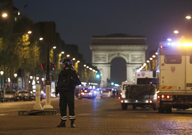 A police officer stands guard after a fatal shooting on the Champs Elysees in Paris, France, Thursday, April 20, 2017.