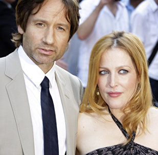 US actors David Duchovny, left, and Gillian Anderson, right, arrive for the British premiere of The X Files: I Want To Believe, in central London, Wednesday, July 30, 2008.