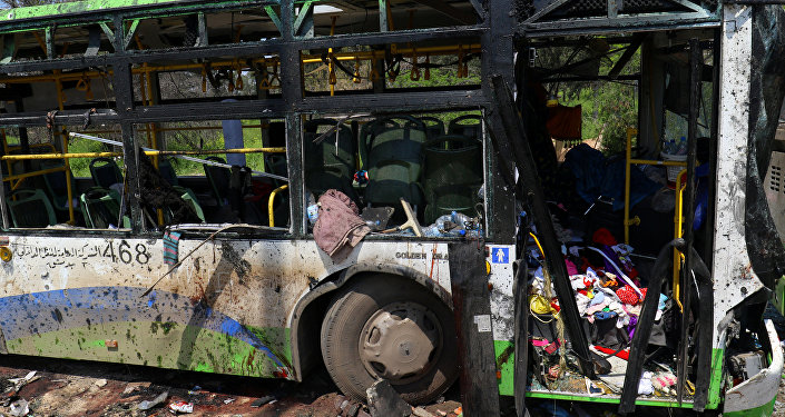 A damaged bus is seen after an explosion at al-Rashideen, Aleppo province, Syria April 15, 2017.
