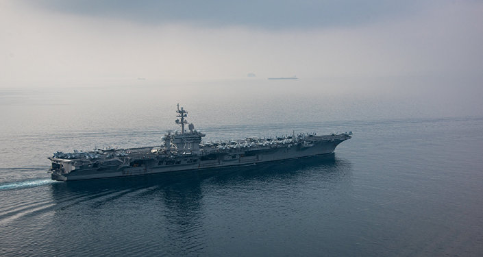 China calls for restraint as United States carrier group heads for Korean waters