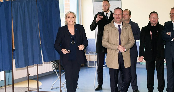 Marine Le Pen, leader of France's National Front (FN) and one of the runners for French presidency, votes in the first round of the French presidential elections at a polling station in Henin-Beaumont.