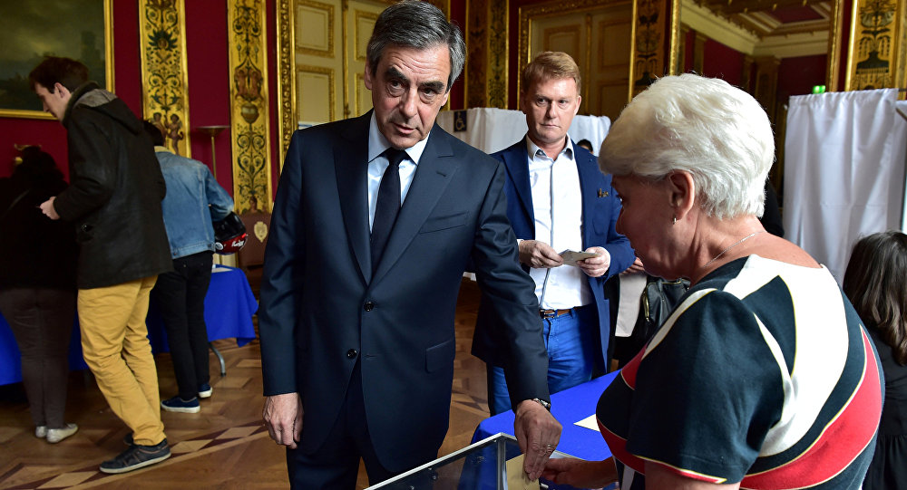 Francois Fillon (L), member of the Republicans political party and 2017 French presidential election candidate of the French centre-right, casts his vote in the first round of 2017 French presidential election in Paris, France, April 23, 2017.
