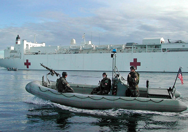 embers of the US Navy SEALS on a rubber boat patrol around the US Navy hospital ship the USNS Mercy